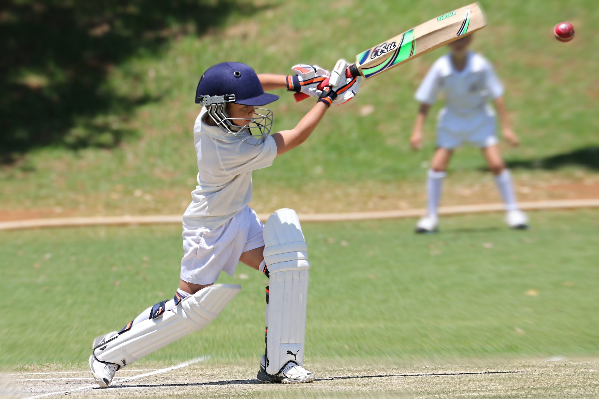 man-in-white-jersey-shirt-and-pants-holding-cricket-bat-3657154