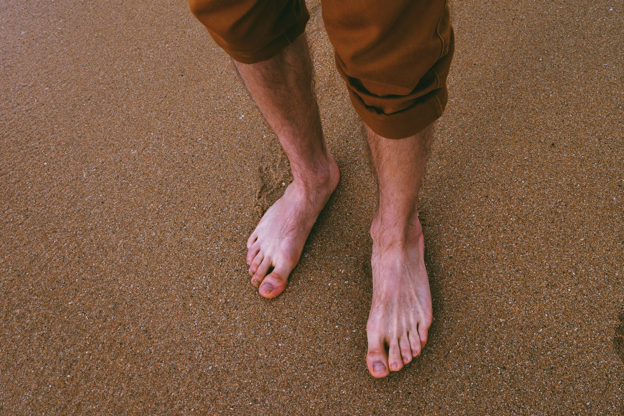 close-up-photo-of-person-standing-on-seashore-1249546